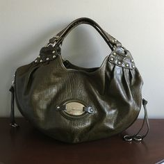 Olive Green Genuine Leather Hobo Purse Silver trim and buckles, lined with leopard print. Dimensions: 18wx11dx11h. Excellent condition. No marks. Comes with dust bag b. makowsky Bags Hobos