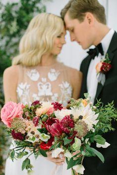 Bold protea, ranunculus and rose wedding bouquet: http://www.stylemepretty.com/2017/03/08/garden-of-eden-inspired-shoot-ending-in-a-real-surprise-proposal/ Photography: Ellen Ashton - http://www.ellenashton.com/