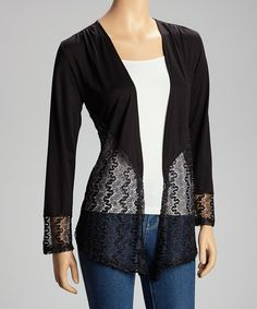 Modern lines and an open silhouette bring balance and structure to this timeless cardigan, while a lace panel adds a flourish of flirty femininity.