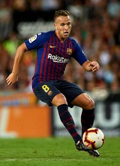 VALENCIA, SPAIN - OCTOBER Arthur of Barcelona in action during the La Liga match between Valencia CF and FC Barcelona at Estadio Mestalla on October 2018 in Valencia, Spain. (Photo by Manuel Queimadelos Alonso/Getty Images) Fc Barcelona, Football Wallpaper, Professional Football, Club, Soccer, Action, Running, Valencia Spain, October 7