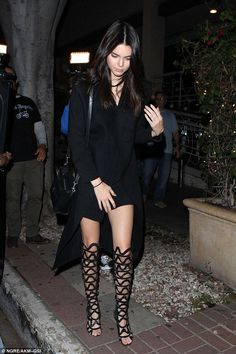 Kendall Jenner wearing Celine Nano Bag and Sophia Webster Mila Cutout Over-the-Knee Boots