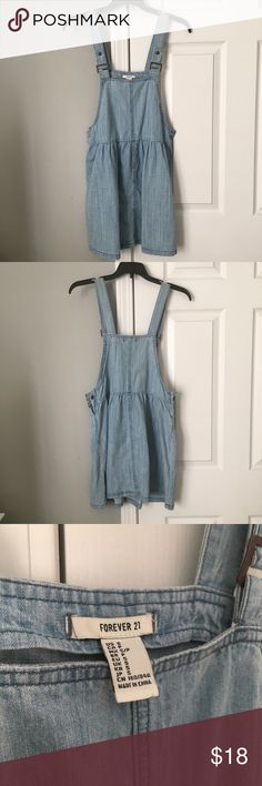 Forever 21 Denim Overall Dress Forever 21 denim overall dress in light wash. Only worn once or twice. Super cute with a cropped top or body suit underneath! Forever 21 Jeans Overalls