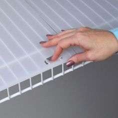 Prevent small items from tipping or falling through wire shelving by using this ClosetMaid White Vinyl Shelf Liner.