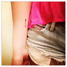 Small arrow tattoo. Because life is like an arrow. It has to be pulled back before it can be shot forward.