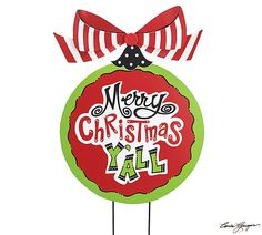 """#burtonandburton Hand-painted wood yard stake in the shape of a large round ornament with """"Merry Christmas Y'all"""" in center. Large red/white stripe tin bow.<br><br>24 1/2""""H X 19""""W.<br>1 set of 2."""
