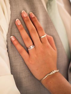 Highlight your engagement ring with a  French manicure and accented ring finger nail.