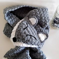 The happiest wolf scarf is unique, quirky, and adorable! His tail pulls through his mouth to keep him in place and create his unique look. He is: - Made with very soft, premium acrylic yarn. - Machine washable on gentle cycle and hang to dry. - 10 at his widest point - 42 long, from