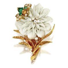 Porcelain, emerald and diamond flower brooch, David Webb. photo courtesy Sotheby's    Mounted in 18 karat gold,