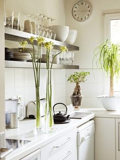I'm including this small kitchen in this category because it's a great use of small space.....via CC