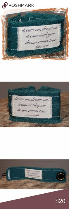 "Dream On Aerosmith Fabric Bracelet Cuff Aerosmith song lyrics ..... dream on! Layers of recycled teal cotton fabric are stitched together Epithet rests on a pile of threads Printed on colorfast fabric & heat set for durability The backing is of the same soft breathable fabric Easily cleans w a wet one Closes w a vintage button & a stretchy loop 7 1/4"" long by 1 5/8"" wide & fits a wrist approximately 6 3/4"" - 8 1/2"" Price is firm unless bundled! Handcrafted Jewelry Bracelets"