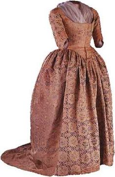 Martha Washington's gown, 1780s    Made of salmon pink faille, Mrs. Washington's dress features a handpainted pattern of flowers and insects. It was first displayed in the original First Ladies Hall, which opened in the Arts and Industries Building in 1914. On loan for many years, the dress became part of the permanent collections in 1929.