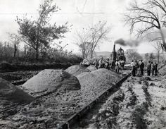 Work crews pour concrete on this stretch of the highway in central Iowa. (1915) http://ow.ly/r3EFG