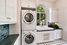 Traditional Laundry Room with MS International Nordic Black Granite, BELLMONT CABINETS - SAVANNAH, Built-in bookshelf