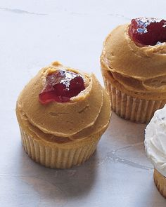 Peanut butter and jelly CUPCAKES!  Makes 18  Ingredients  1 3/4 cups all-purpose flour  3/4 tablespoon baking powder  1/2 teaspoon salt  1/4 teaspoon baking soda  6 ounces (1 1/2 sticks) unsalted butter, softened  1 1/3 cups sugar  2/3 cup creamy peanut butter  3 large eggs  1/2 cup sour cream  1/2 teaspoon pure vanilla  Peanut Butter Frosting & Strawberry jam, for topping  Directions  Make adding peanut butter before adding eggs. Use sour cream and vanilla as wet ingredients. Frost when…