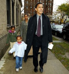 Illinois Democratic Senate candidate Barack Obama leaves with his wife Michelle, daughters Sasha, front left, and Malia after voting at Catholic Theological union polling place in Chicago on Nov. Nam Y Huh, AP