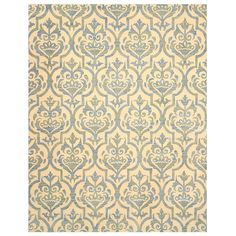 The Miron area rug highlights a hand-tufted wool construction with a soft pile underfoot, and cotton backing. This accent piece also offers a gorgeous color palette, and a floral pattern design.