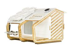 """The """"K-9 Deluxe"""" by Taparchitecture. This eco-friendly doghouse includes a 5-gallon, roof-top rainwater collection tank that feeds a water bowl. The ventilation system and interior lighting are both solar powered."""