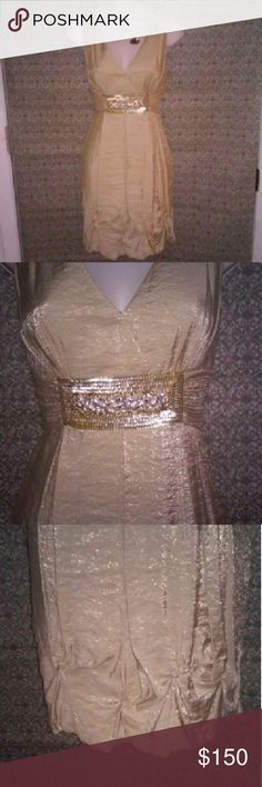 """MONDAY MADDNESS!! PRICE CUT! TODAY ONLY! Beautiful shimmering gold dress. Wrapped waist line with eye catching sequined embellished underbust. Zip up back and pleated ruffled bottom. Gathers on the bottom are stitched in place with little swirls of fabric. No rips, or stains. EUC! Zipper is in perfect condition. 70% rayon and 30% nylon shell. 100% acetate length from armpit is 25.5"""" waist is 28"""" around. BCBGMaxAzria Dresses Mini"""