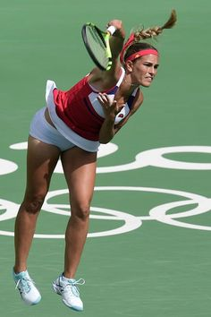 Puerto Rico's Monica Puig serves the ball to Czech Republic's Petra Kvitova during their women's singles semifinals tennis match at the Olympic. Monica Puig, Wta Tennis, Sport Tennis, Female Volleyball Players, Tennis Players Female, Blush Lingerie, Tennis Photography, Tennis Pictures, Legends Football
