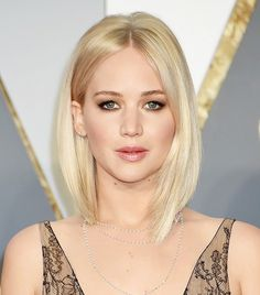 Jennifer Lawrence's is a bombshell with her perfect lob, nude lip, and sultry eye makeup