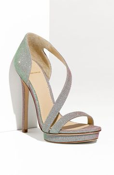 I've been obsessed with Brian Atwood since I saw Anne Hathaway's sparkly shoes at the Oscars. I don't need these shoes, and I'm not sure I could walk in them...but, so pretty.