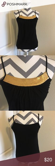 BCBG sequins tank top Black BCBG tank top with gold sequins trim. Straps are adjustable. I also have this available in white... BCBGMaxAzria Tops