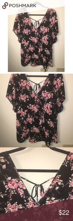 NWOT!!! Torrid Chiffon Tunic Top Super cute Tunic style top with open short sleeves; tie in back; double v neck in front and back; elastic waist; float bottom; semi sheer; black background with pink flower pattern; pair with skinny jeans for the perfect top for a night out!!! Torrid size 2 = 2x torrid Tops Blouses