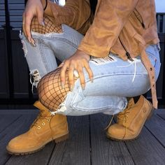 Love the ripped jeans and booths with the camel suede jacket! Sexy touch with the fishnets under!