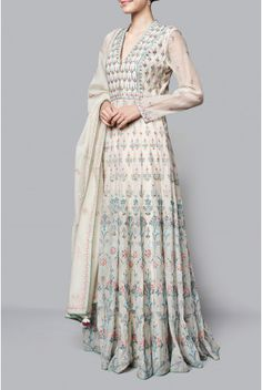 The natural hued Inikaara suit boasts of its summer floral motifs. With sheer sleeves and a flattering floor length silhouette, the chanderi mull kurta  paired with a churidar and dupatta, is embroidered with rich Rajasthani crafts of gota patti, dori, sequin, zari and pearl work. Fabric: Chanderi Mull Content: 70% COTTON / 30% SILK Production time: We require 6-7 weeks to dispatch this outfit