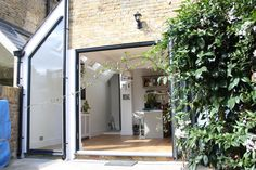 Double doors and large architectural window in the new side return extension, Open Space London Kitchen Extension Side Return, Kitchen Diner Extension, Extension Plans, Side Extension, Pergola Plans, Pergola Kits, Kitchen Conversion, House Extensions, Kitchen Extensions