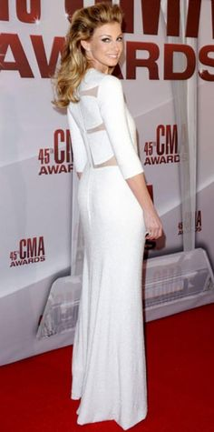 Look of the Day › November 10, 2011 WHAT SHE WORE Faith Hill turned heads in a white hot Chado Ralph Rucci column and Neil Lane earrings at the Country Music Association Awards. WHY WE LOVE IT The sultry songstress worked every angle of her peek-a-boo design