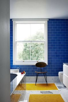 Blue Tiles Yellow Bathmats in Modern Bathroom Ideas. Petrol blue tiles have been paired with bright yellow bathmats for a surprisingly graphic look. Small Bathroom Tiles, Yellow Bathrooms, Bathroom Colors, Bathroom Ideas, Colorful Bathroom, Bathroom Organization, Bathroom Wall, Master Bathroom, Shower Ideas