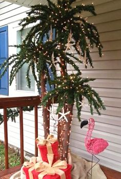 Outdoor palm Christmas tree with lights, flamingo and gifts. Submitted to Completely Coastal Facebook page by Beth Walker Dobbins.