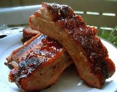 I package of beef ribs (approx 10-12)  1/4 cup prepared mustard  1 can Salsa de Chile De Fresco (optional) it's basically spicy tomato sauce  3/4 cup brown sugar  1/8 cup white vinegar (helps with tenderizing)  3/4 cup mesquite BBQ sauce