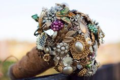 Google Image Result for http://wedding-pictures-03.onewed.com/33637/wedding-flower-alternatives-bridal-bouquets-from-etsy-gold-ornate-brooches.jpeg