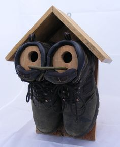sparrow nest box out of a pair of old boots