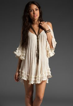 open shoulder dress-- I'd bring the clevage line up and close the shoulders a bit, also, I'd wear this as a shirt, not a dress.