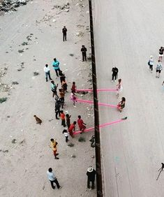On Saturday, professors Ronald Rael and Virginia San Fratello placed bright pink seesaws on the border wall at Juarez, Mexico and El Paso, Texas. Art Installation, Us Mexico Border Wall, Donald Trump, San Jose State University, Virginia, Conceptual Drawing, Us Border, Seesaw, Playground
