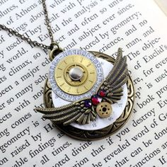 VOLCANO WINGS CABPWF131  $33.00  Antique watch and pocket watch face necklace with wing charms and Swarovski crystal elements.