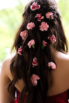 Wavy wedding hair with pink carnations | Brides.com
