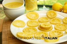The Slow Roasted Italian: Candied Lemon Slices. Really worth the work. Slices would be great on top a lemon cake. Candied Lemon Slices, Candied Lemons, Candied Fruit, Lemon Desserts, Lemon Recipes, Recipe Using Lemons, Great Recipes, Favorite Recipes, The Slow Roasted Italian