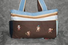 One of the first bags I made these monkeys found a home on stripped fleece and brown flannel.