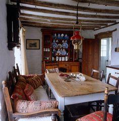 bohemian kitchens | Farmhouse Kitchen: Kilim Cushions and odd chairs
