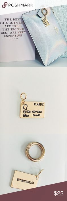 """Credit Card BAE Charm Keychain for Handbag This gold credit card charm is designed by me! The credit card charm is oh so charming and engraved with the words """"plastic"""" as the fake credit card company name. """"4/20"""" is the expiration date. """"Bae"""" is of course, your signature! The card number has secret Roman numerals as the card number. """"amannequin"""" is also engraved on the back. It comes with a key ring that opens and closes. Charm your bags, keychains, rope bracelets, etc.. Material: Alloy. How…"""