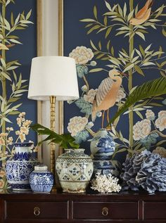 Summer Thornton Framed Chinoiserie panels, a collection of blue and white Chinese porcelain, coral, and a real palm frond combine in this lovely blue and white vignette.