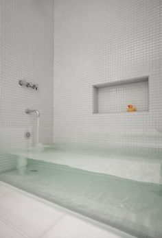 I had never before seen a glass-sided bathtub, and this one completely appeals to my minimalist tendencies. The architect, David Stern, says the client wanted this custom made tub for the kids bathroom and wanted it to feel fresh and fun. Well, he succeeded. But here is what I want to know: Why should the kids have all the fun?