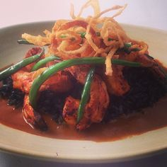 New Frontera Menu Hilite: grld fresh Gulf shrimp, bl bean rice, red peanut pipian, smoky gr beans, crispy onions