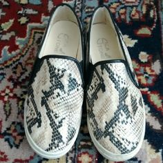 Snake print slip-on sneakers Cool snake print sneakers. Comfy and stylish. Only worn a few times (the soles will get a wash!). I thought they were a size 7, but they fit more like 6. Tobi Shoes Sneakers