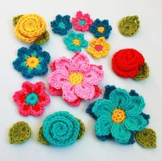 Crochet Pattern - Flower Shower (4 flowers embellishments and leaves)
