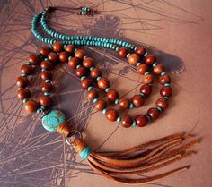 Leather Tassel Necklace Turquoise Stone Natural Wood Bead Necklace Tassel Pendant Rustic Earthy Bohemian Necklace Long from prayerfeather on Etsy.